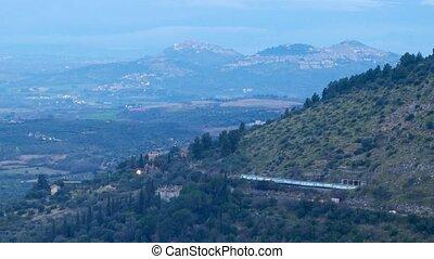 The train travels along the slope. Dawn. Tivoli, Italy