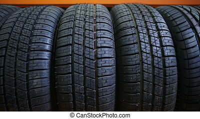 Car tires in a row - winter car tire at store
