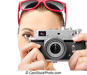 Pretty woman photographer isolated on a white background
