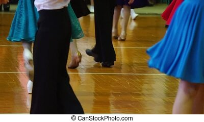 Close-up of legs dancing couples in ballroom. - Close-up of...