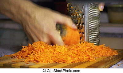 Cutting Carrot Grater - Carrots on a grater rubbed on the...