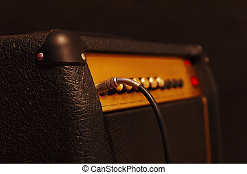 Combo amplifier for electric guitar with inserted input jack...