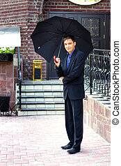 Man in black with an umbrella