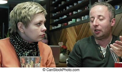 Couple man and woman eats talks in cafe restaurant - Couple...