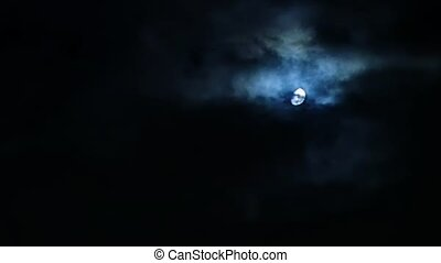 Storm clouds over moon at night on overcast sky - Storm...