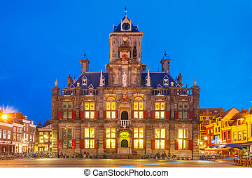 Markt square at night in Delft, Netherlands - City Hall on...