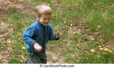 Happy little boy runs with rod laughs and smiles - Happy...