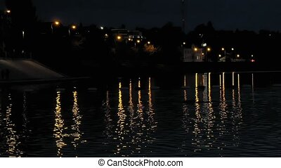 Beautiful lights reflection in water at night. - Beautiful...