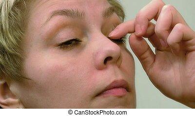 Pretty woman applying eyelashes mascara makeup - Pretty...