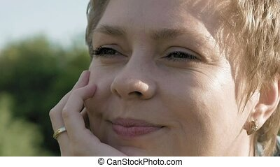 Blond woman with beautiful smile portrait outdoor - Pretty...