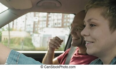 Couple in car talk smile and laugh and man leaves