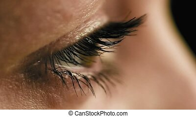 Female eyes closeup side view slow motion - Female woman's...