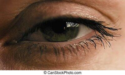 Female eye closeup slow motion - Female woman's eye closeup...