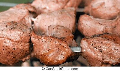 Barbecue skewers with meat cooking on the grill
