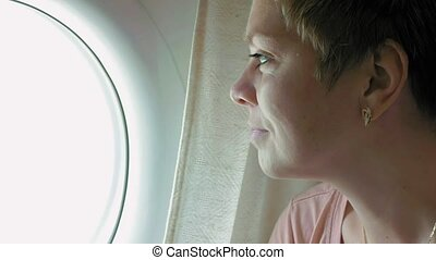 A passenger sitting on a plane enjoying the view - A...