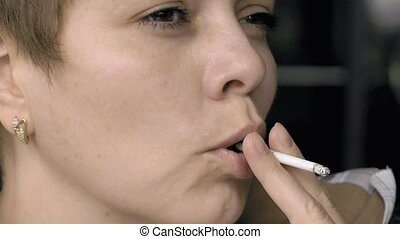 Smoking female with a cigarette in her hand