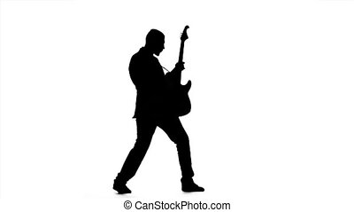 Chords on the guitar. Man in full growth. Slow motion -...