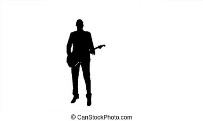 Male plays the guitar and jumping to the music - Male plays...