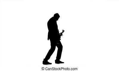 Guitarist plays the melody. Silhouette. Slow motion -...