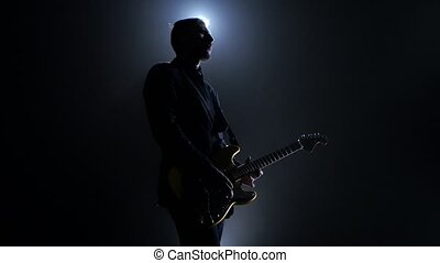 Man performs a concert. Electric guitar yellow color - Man...