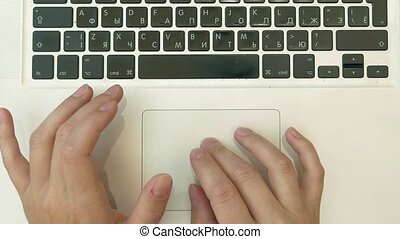 Using a laptop pc - Top view of woman's hands typing on a...