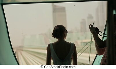 Love couple ride on a train Dubai Metro and photographed