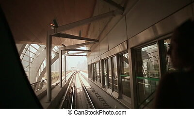Love couple ride on a train Dubai Metro in a summer day 2