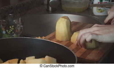 Close up of a potato cooking. - Concept: homemade, family....