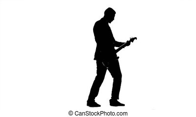 Musician pluck the strings electric guitar. Silhouette -...