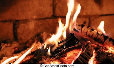 Burning flame fire in a fireplace. Warm and cozy. - Burning...