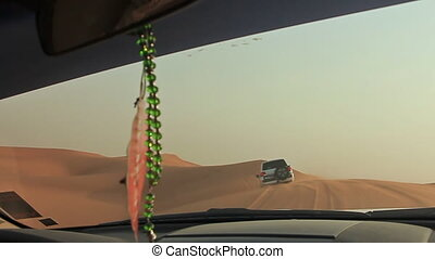 Desert Safari SUVs bashing through the arabian sand dunes....