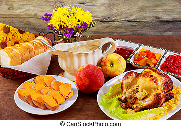 Roasted chicken. Thanksgiving table served with , decorated...