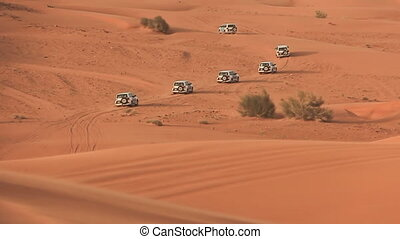 Desert Safari SUVs bashing through the arabian sand dunes 3...