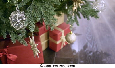 New Year's and Christmas tree decoration in shopping mall whith gift box