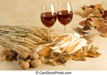 Delicious autumn - Red wine in an autumn decor with leaves,...