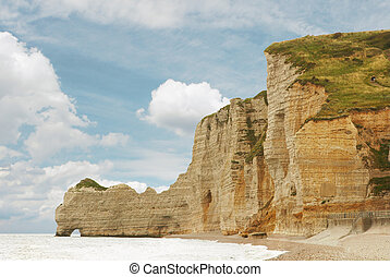 Etretat - One of the arches in the chalk cliffs at Etretat,...