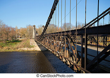 Ancient chain suspension bridge (1853) in the sunny October...