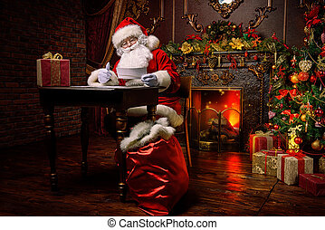 Santa is working - Santa Claus is preparing for Christmas,...