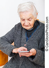Timeless communication - Picture of an old woman holding a...