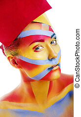 woman with creative geometry make up, red, yellow, blue...