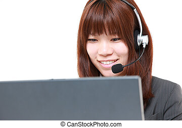 young Japanese businesswoman of call center with head sets