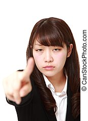 young Japanese businesswoman scolding - concept shot of...
