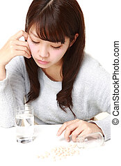 young Japanese woman suffers from melancholy - studio shot...
