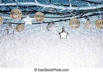 christmas decorations and holiday lights hanging on bare branches