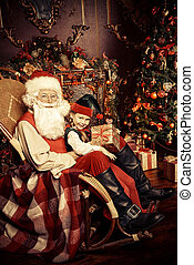 believe in miracles - Santa Claus and the elf girl with gift...