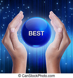 Hand showing blue crystal ball with best word. business concept