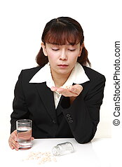 Asian businesswoman suffers from melancholy - concept shot...