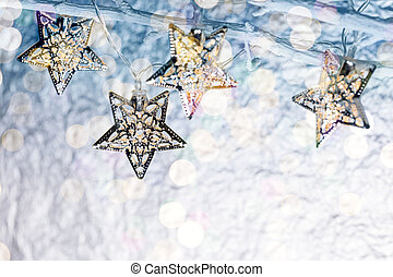 christmas star-shaped holiday lights hanging on bare branches