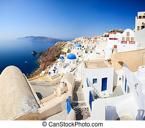 Traditional white and blue village in Santorini -...
