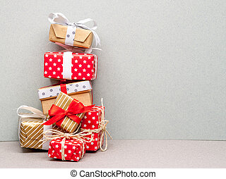 high pile of christmas gifts - high pile made of different...